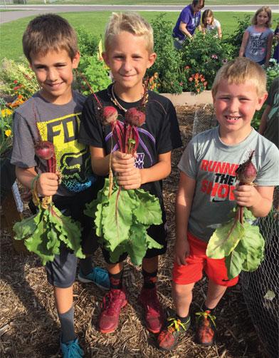 Three Boys in School Garden